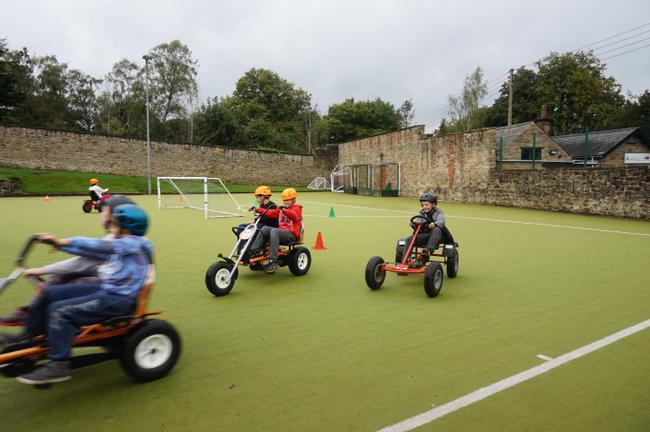 Whizzing about on buggies.