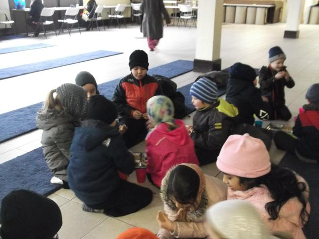 Children loved sharing food at the Sikh Gurdwara