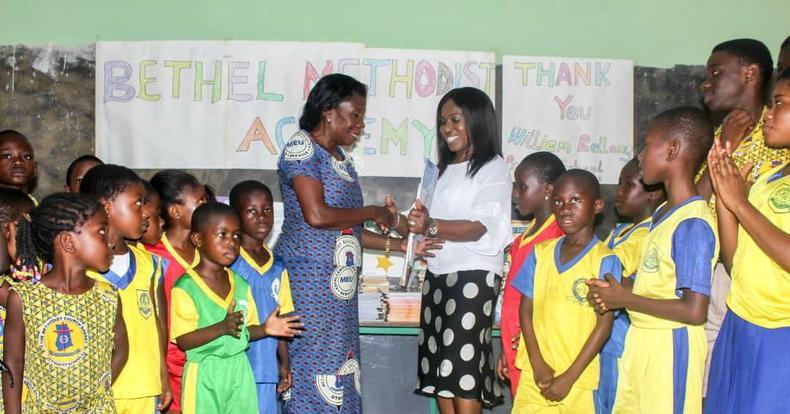 The formal presentation of our books to the Head Teacher of Bethel Academy in Ghana