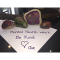 'Be Kind' painted stones by Joe