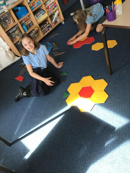 Chloe has created a beautiful flower using shape tiles