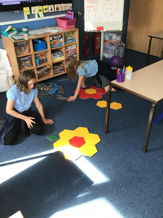 The girls in Rowan working together to create shapes
