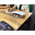 We use slanted boards to support our writing.