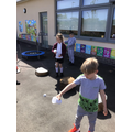 We created our own cup and ball toy.