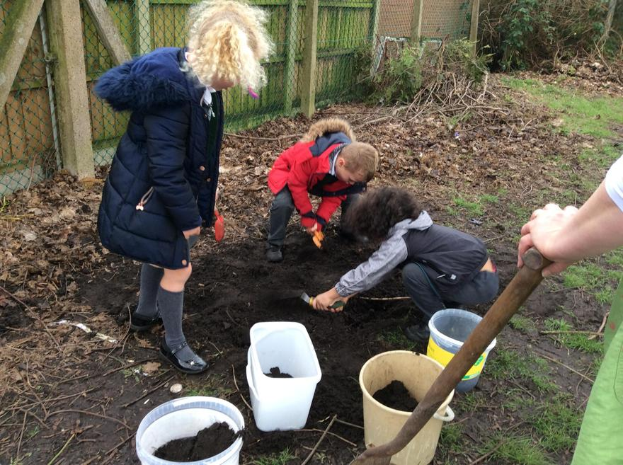 Collecting soil for the planters