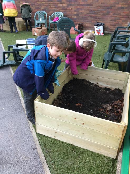Filling the planters was hard work!