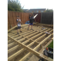 Oliver&Ben laying decking with their Dad!