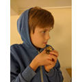 Cole and 1 of the chicks they have hatched.