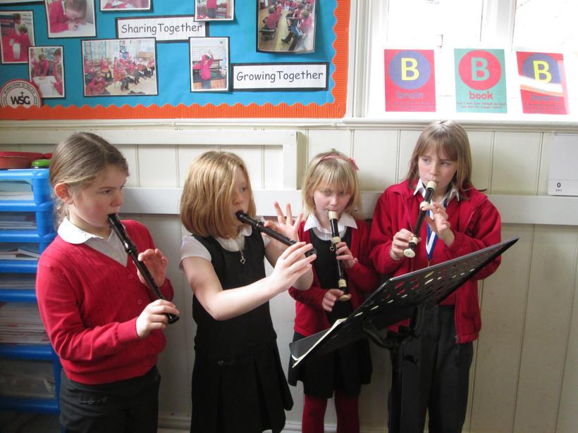 Some of the group playing 'Hot Cross Buns'