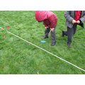 Measuring carefully in metres and centimetres.