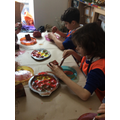 Using sponges and paintbrushes to create different patterns