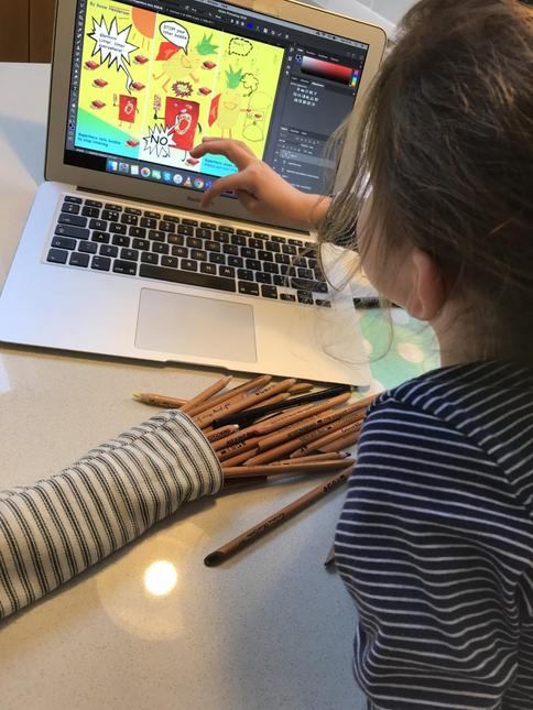 Rosie making her comic strip on the computer
