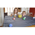 A solar system takes over the dining room table!