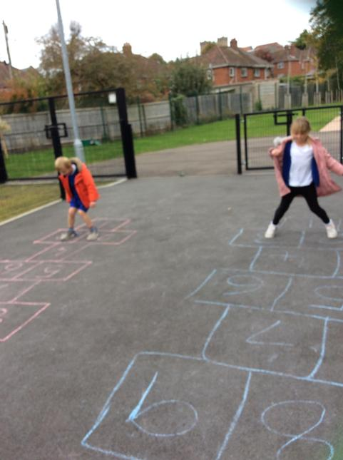 Hopscotch together outside.