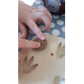 George uses a fossil to imprint a fossil!