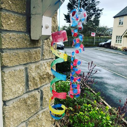 Some creative wind chimes from bottles by Daisy!