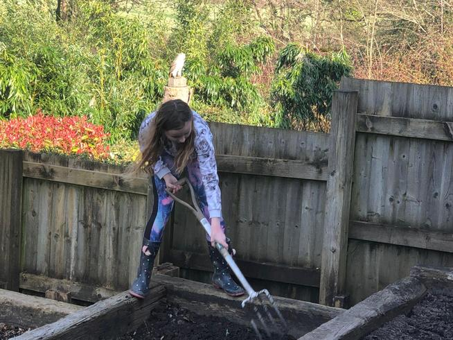Isabel has been helping with the gardening.