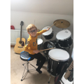 We have a musician on our hands-Aleks on the drums