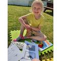 Emilie-joy enjoying some dinosaur fun in the sun!