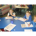 Writng fantastic sentences in our pink books.
