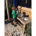 Creative mud kitchen play