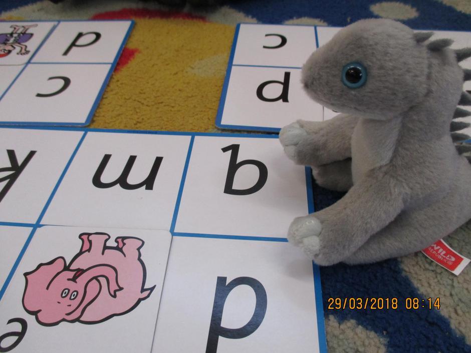 Dave the Diplodocus playing alphabet bingo
