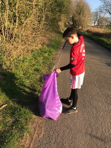 Sam on a litter pick.