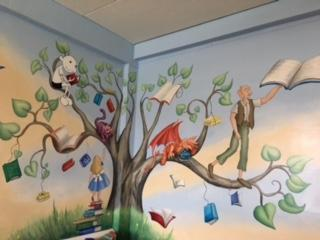 Our library mural created by Rachel Blackwell using the ideas of Witton pupils.