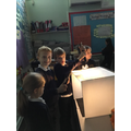 Using a light box to photograph artefacts.
