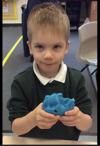 Creating sculptures in the style of Barbara Hepworth.