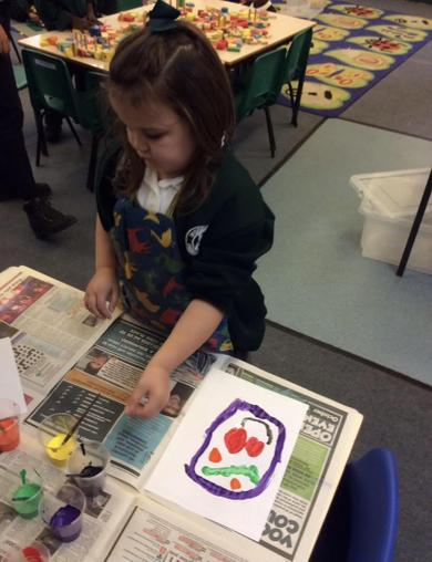 Painting portraits in the style of Picasso.
