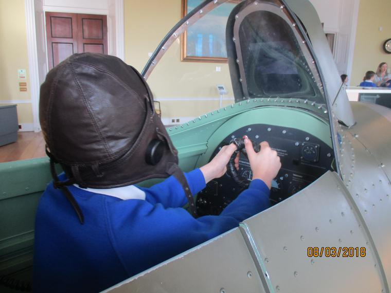 Exploring the cockpit of a Spitfire.
