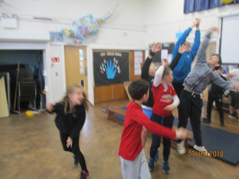 We practised throwing and catching skills
