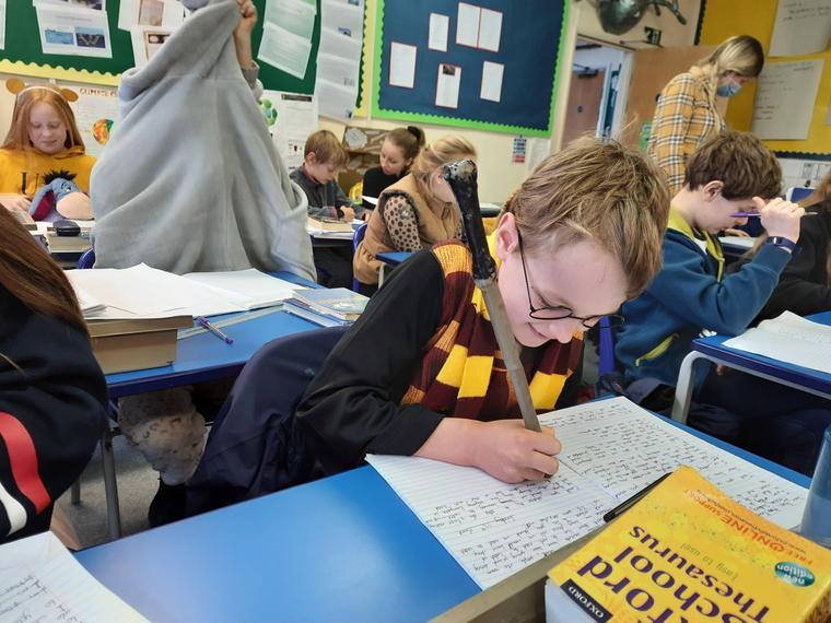 Harry Potter writing spells!