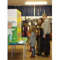 Pupils and parent in the 'Art Gallery' at Woodcote