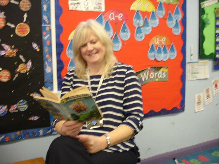 Mrs Beresford enjoying the author Roald Dahl.