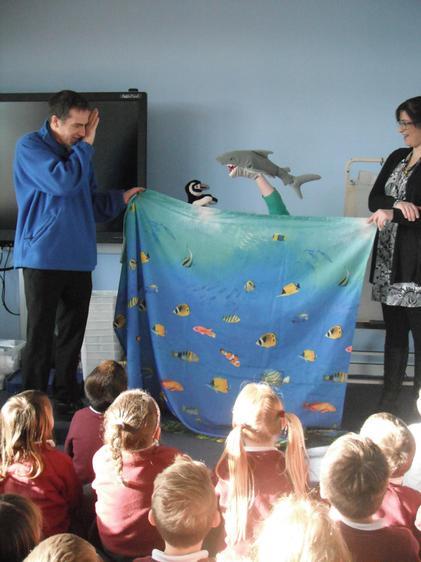 Puppet show... Oh no!  A predator... a shark!