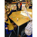 We made scarecrow hand puppets.