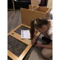 Sophia building her work station