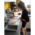 Sophia baking a lemon drizzle cake
