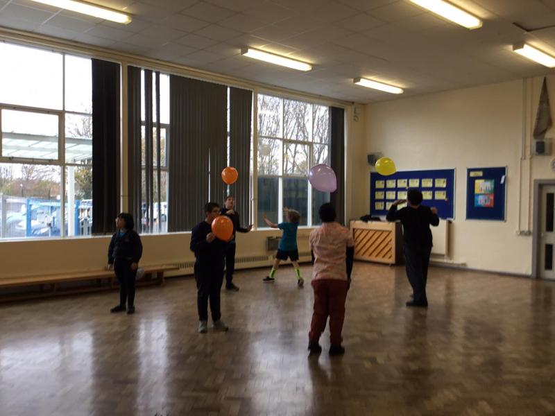 Working with balloons in PE.