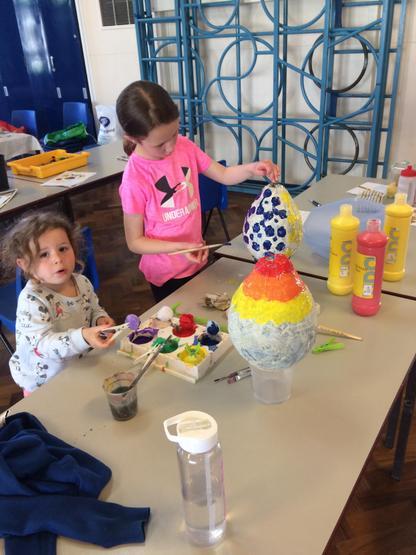Painting our giant paper mâché eggs