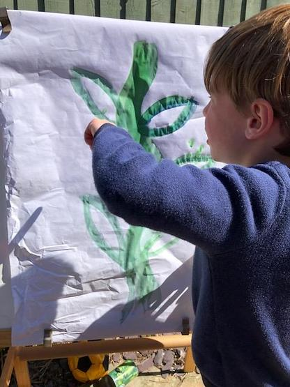 Painting a bean stalk outdoors