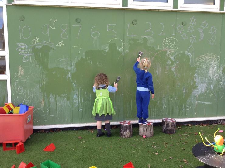 We practised our numbers using chalk and water.