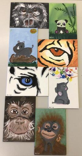 April painted a picture for each class. They are on display outside our classroom.