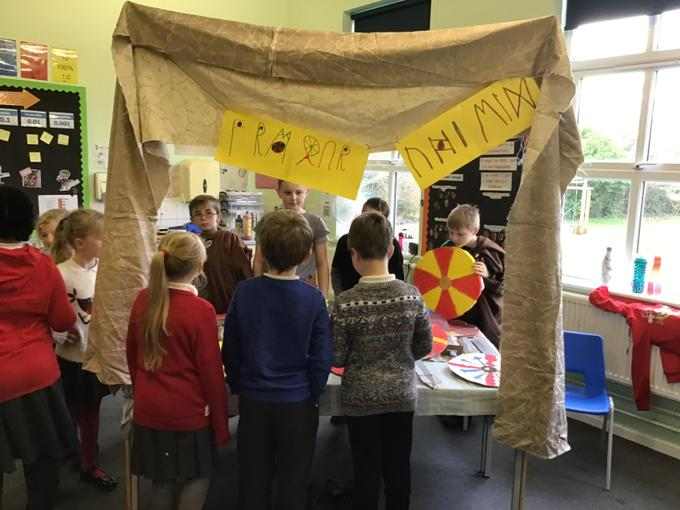 Our armour stall with banners in runes.