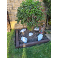 Emily has been gardening and made her own rockery