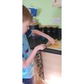 Isaac having a go at chopping!