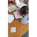 Ella practising her handwriting.
