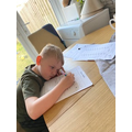 Logan has been busy doing his maths work!